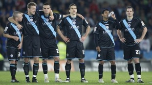 Leicester City players appear dejected after being knocked out of the play offs after the final whistle.