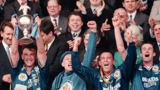 Leicester City captain Steve Walsh, with cup, celebrates their 2-1 win over Crystal Palace at Wembley