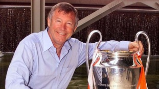 Sir Alex Ferguson with a trophy