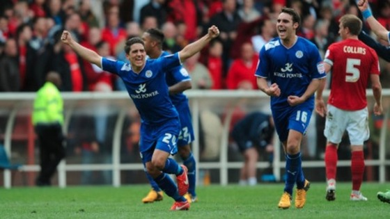 Leicester City's Anthony Knockaert (left) and Matty James (2nd right) celebrate as the final whistle blows against Nottingham Forest