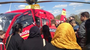 Children from Small Heath School in Birmingham watching air ambulance demonstration.