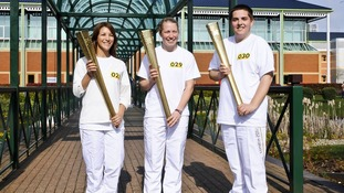 Three torch bearers holding torch