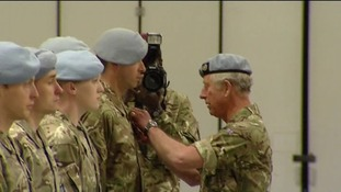 Prince Charles presenting service medals to soldiers who served in Afganistan