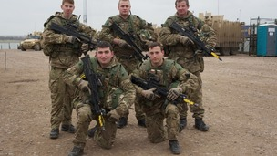 5 soldiers pose with guns