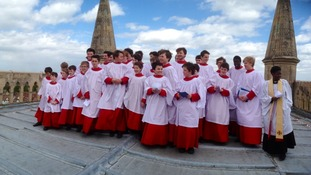 Choir performs Ascension Day carol at the top of the tower