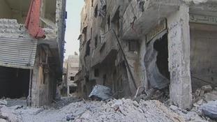 Deserted bomb-damaged streets of Syrian capital Damascus
