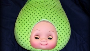 One of the recalled fruit-head dolls