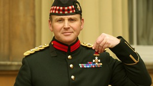 Colonel Edward Fenton after he received his Distinguished Service Order medal for Services in Afghanistan from the Prince of Wales.