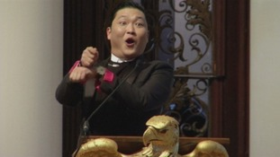Psy breaks out his signature 'Gangnam Style' moves during the speech