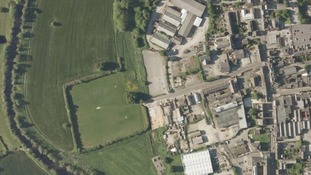 The industrial site is on the edge of Belper close to fields and the Derwent River