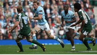 Leicester Tigers Tom Croft takes on London Irish's Richard Thorpe