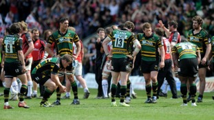 The Northampton players stand dejected on the final whistle