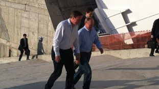 David Cameron (L) tours the Winter Olympic Stadium with Vladimir Putin
