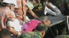 Reshma is carried away on a stretcher moments after being freed from the wreckage