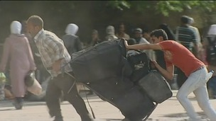 Locals in the Yarmouk district of the Syrian capital Damascus are pacing their bags and leaving.