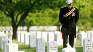 Britain's Prince Harry pauses while visiting Section 60 at Arlington National Cemetery.