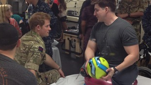 Prince Harry with US Army Staff Sergeant Tim Payne, who lost both his legs in Kandahar.