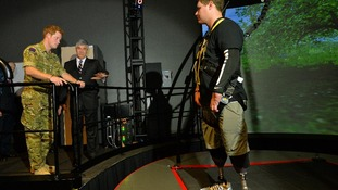Prince Harry talks to Corey Garmon, 24, who lost both his legs after stepping on a Taliban bomb.