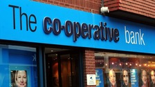 "The Co-operative Bank's investment grade rating has been slashed to ""junk"" status"
