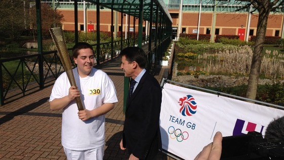 Lord Coe meets one of the torch bearers at Loughborough University. This is Lord Coe's old university.