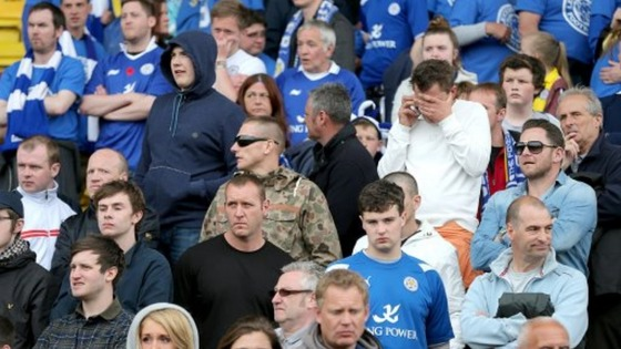 Leicester City fans look dejected in the stands after the final whistle
