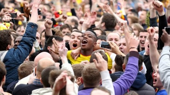Watford&#x27;s Nathaniel Chalobah is mobbed by home fans on the pitch after the final whistle