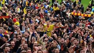 Watford fans on the pitch after the npower Football League Championship match at Vicarage Road.