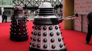 Two daleks patrol the red carpet