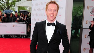 Damian Lewis smiles for the cameras at the BAFTAs