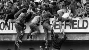 Liverpool fans trying to escape severe overcrowding at Hillsborough in 1989.