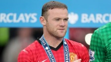Wayne Rooney celebrates Manchester United winning the Premier League.