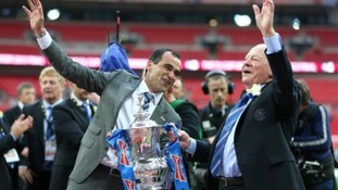 Martinez  celebrates with chairman Dave Whelan and the FA Cup trophy, after their victory over Manchester City