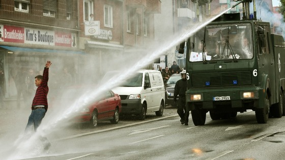 Police with water cannons pushes back people in Germany.