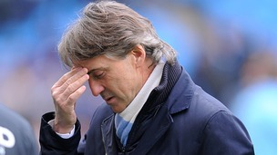 Roberto Mancini was celebrating Premier League glory less than a year ago