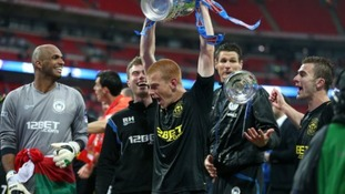 Wigan Athletic winning goalscorer Ben Watson celebrates with the FA Cup trophy, after their victory over Manchester City