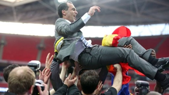 Wigan Athletic manager Roberto Martinez is held aloft by his players following their victory over Manchester City