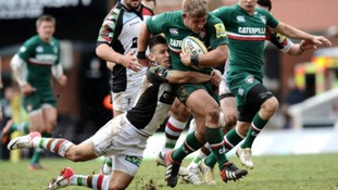 Harlequins' Danny Care tackles Leicester Tigers' Tom Youngs