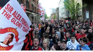 Manchester United fans queue to enter Albert Square