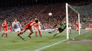 Trevor Francis of Nottingham Forest (l) heads the winning goal past Malmo goalkeeper Jan Moller (r)