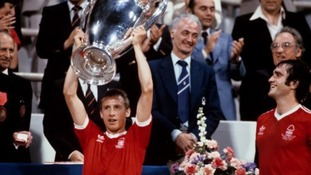 Nottingham Forest's Larry Lloyd (right) looks on as captain John McGovern (left) lifts the European Cup