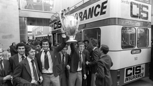 Nottingham Forest's Larry Lloyd, third left, and Ian Bowyer, third right, hold the European Cup aloft as they tour Nottingham