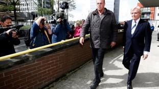 Coronation Street actor Bill Roach (right) leaves Preston Magistrates' Court