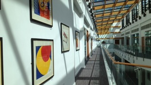 A wall of Alexander Calder art work on a 3rd floor mezzanine.