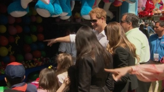 Prince Harry joins children at a fairground attraction