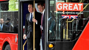 David Cameron and Prince Harry disembark the Routemaster bus