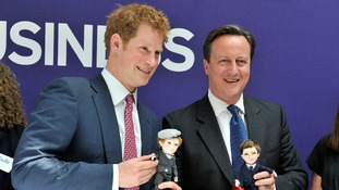Prince Harry and the Prime Minister pose with their lookalike dolls