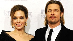 Angelina Jolie and Brad Pitt attending the premiere of her movie 'In the Land of Blood and Honey' in Bosnia.