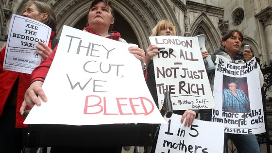 Protesters against the 'bedroom tax' gather outside the Royal Courts of Justice in London.