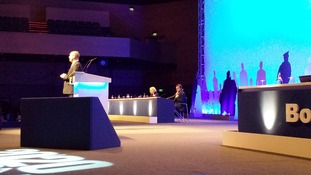 Theresa May listens to Police Federation Chair Steve Williams address the conference