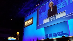 Theresa May addresses the conference